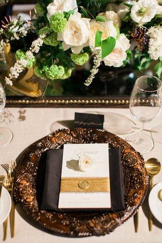 wedding-reception-masculine-aesthetic-greenery-neutral-bronze-studs-leather-mirror-dark-wood-wax