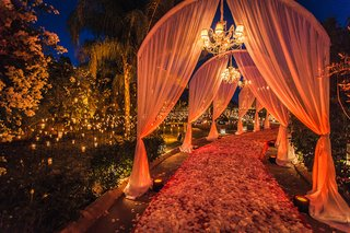 drapery-over-pathway-flower-petals-marrakech-morocco-destination-wedding-ceremony-opulent-outdoor