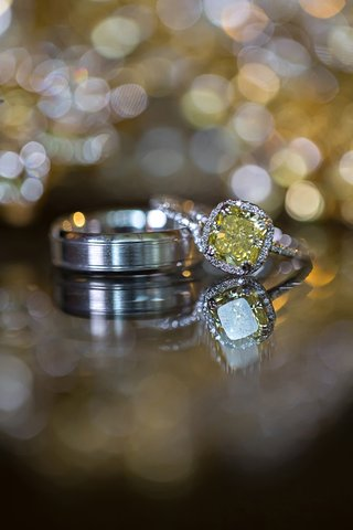 yellow-diamond-halo-engagement-ring-with-platinum-wedding-band