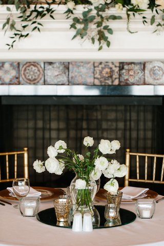 mirror-disk-on-wedding-reception-table-with-vase-filled-with-white-flowers-at-reception