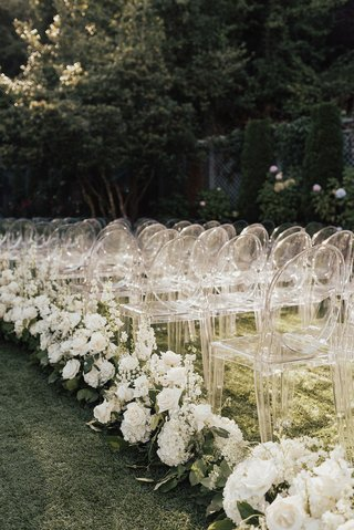 outdoor-wedding-ceremony-on-grass-lawn-guest-chairs-ghost-clear-white-rose-hydrangea-stock-greenery