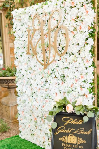 wedding-reception-photo-guest-book-booth-with-flower-wall-made-by-bride-monogram-garden-roses-gold