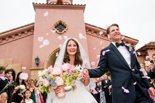wedding-guests-tossed-flower-petals-at-the-bride-and-groom-as-they-left-the-ceremony-space