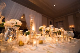 gold-and-ivory-wedding-head-table-white-drapery-behind