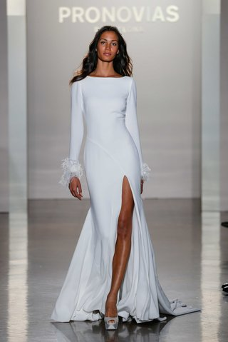 nuria-pronovias-high-slit-crepe-skirt-high-neckline-embroidery-long-sleeves-feathers-cuffs