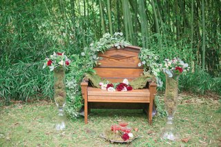 wooden-bench-vines-green-red-blush-flowers-tall-vases-outdoor-celtic-wedding