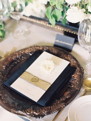 ivory-menu-card-with-frayed-gold-ribbon-and-wax-seal-belly-band-single-gardenia-flower-on-wood
