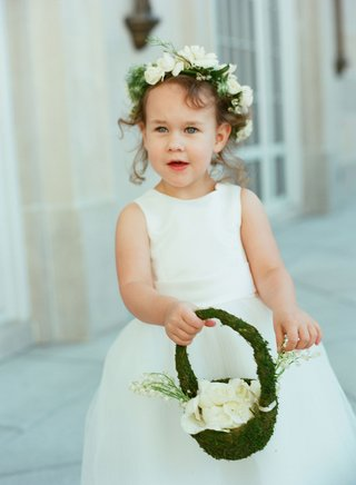 flower-girl-in-white-ball-gown-with-moss-basket-of-greenery-and-white-flower-petals-flower-crown