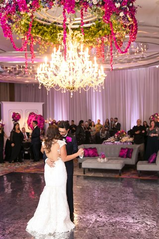bride-in-cristiano-lucci-wedding-dress-with-open-back-first-dance-under-chandelier