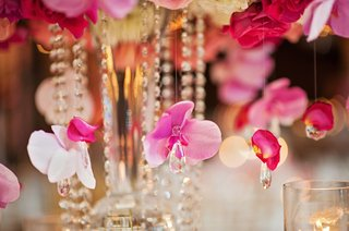 pink-orchids-hanging-from-centerpieces-with-crystal