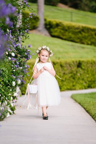 adorable-flower-girl-with-flower-crown-basket-in-crook-of-arm-black-shoes