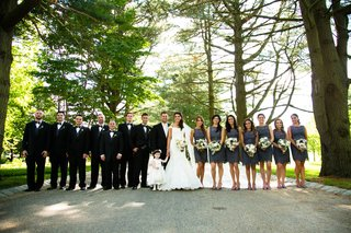 bride-and-groom-with-bridesmaids-and-groomsmen-under-trees