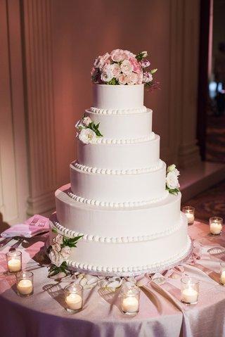 white-wedding-cake-with-beading-and-fresh-roses