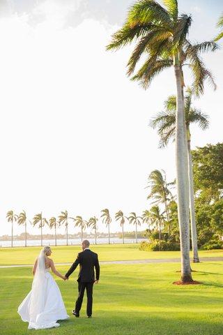 wedding-portrait-couple-bride-and-groom-tuxedo-veil-tall-palm-trees