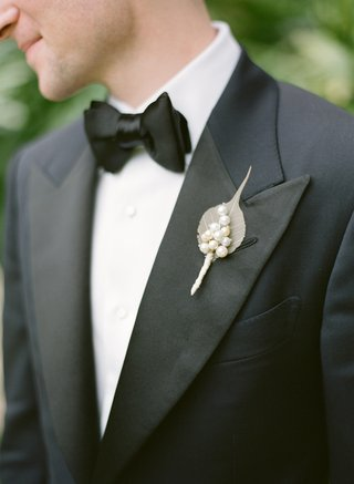 groom-in-tuxedo-and-bow-tie-with-pearls-on-lapel
