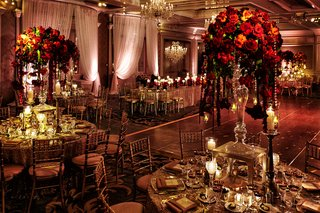 four-seasons-chicago-wedding-reception-crystal-and-red-rose-centerpieces-with-gold-linens-and-chairs