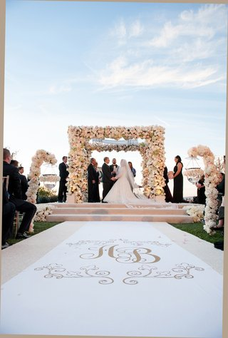 monogram-aisle-runner-and-floral-chuppah