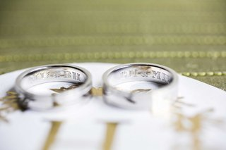 grooms-wedding-bands-engraved-with-each-others-initials