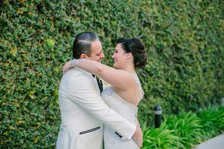 bride-in-martina-liana-hug-white-tuxedo-jacket-after-first-look