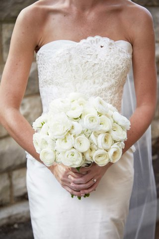 bride-in-strapless-elizabeth-fillmore-wedding-dress-holding-all-white-bouquet-of-ranunculuses