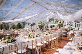 wedding-reception-st-louis-clear-tent-greenhouse-drapery-long-table-trees-low-high-centerpieces