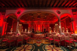 ruby-lights-covering-gold-tables-and-chairs