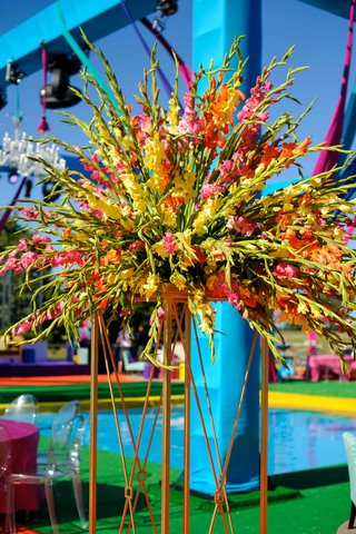 a-vibrant-floral-arrangement-of-long-stems-and-white-orange-and-pink-flowers