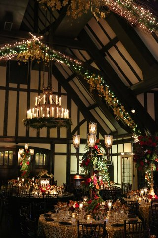 wedding-reception-with-christmas-decorations-lights-candelabra-and-chandeliers-with-candles