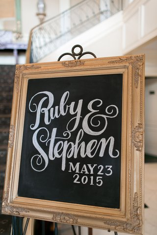 wedding-reception-chalboard-sign-in-decorative-wood-frame-bride-grooms-names-wedding-date