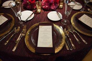 gold-tableware-gold-and-ivory-menu-purple-linen-pink-flower-centerpiece