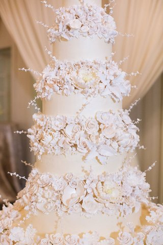 wedding-cake-opulent-new-years-eve-wedding-ivory-fondant-layers-and-sugar-flowers-on-each-tier