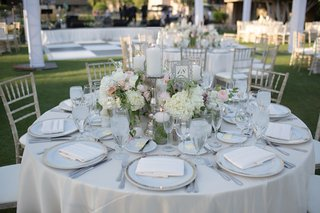 outdoor-wedding-reception-table-with-white-roses-hydrangeas-peach-and-pink-peonies-purple-roses