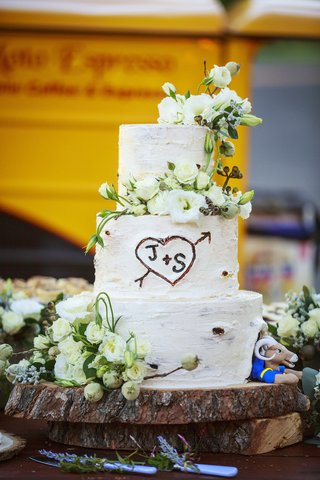 white-wedding-cake-that-resembles-a-tree-trunk-has-couples-initals-carved-st-louis-rams-rampage