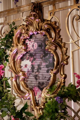 ornate-gold-frame-displaying-floral-fabric