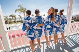 bride-bridesmaids-patterned-navy-robes-leaves-tropical-hotel-del-coronado-wedding