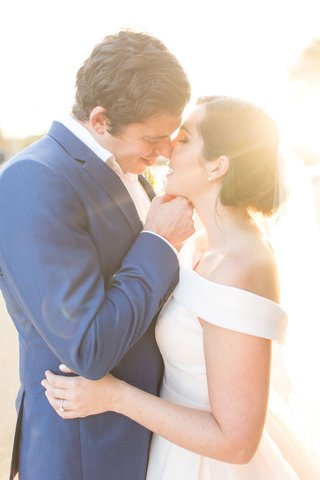 the-confused-millennial-off-shoulder-ball-gown-wedding-dress-navy-groom-suit-almost-kiss-sunlight