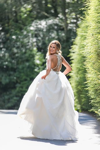 bride-in-hayley-paige-a-line-wedding-dress-with-illusion-back-and-jewel-beading-design