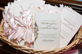ivory-wedding-program-basket-with-gold-writing-and-light-pink-ribbon