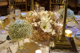miniature-floral-arrangement-centerpieces-with-white-flowers-and-a-small-amount-of-greenery
