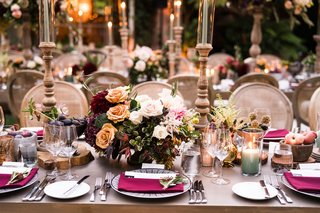 wedding-reception-table-wood-with-burgundy-flowers-napkins-candles-taper-candles-outdoor-wedding