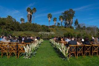 echosmith-singer-sydney-sierota-and-cameron-quiseng-outdoor-wedding-ceremony-pampas-grass-vineyard