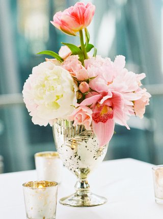 small-floral-arrangement-pink-white-and-greenery-in-gold-vase-small-candles-white-table-linen