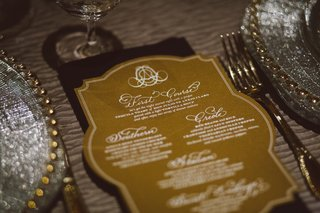 white-and-gold-menu-card-with-calligraphy