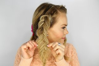 bride-doing-fishtail-braid-wedding-day-hairstyle-diy