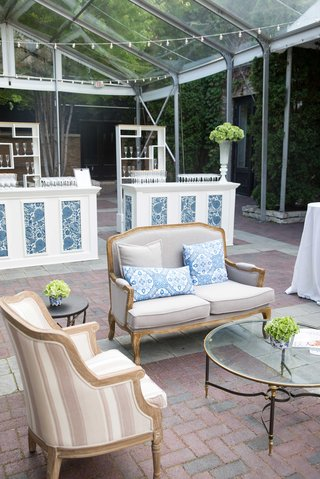 outdoor-setting-blue-and-white-wedding-decor-srting-lights-pattern-panels-armchairs-sofas