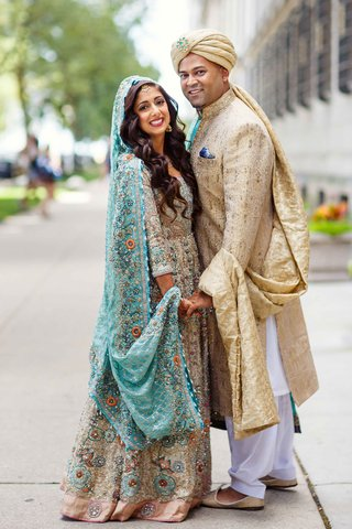 bride-and-groom-posing-in-traditional-pakistani-garb-before-their-shaadi-wedding-ceremony