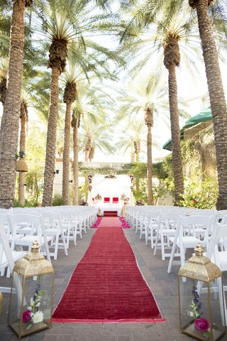 south-asian-wedding-inspiration-palm-trees-red-carpet-aisle-runner-lanterns-framing-aisle