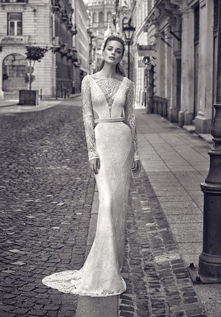 b-w-photo-of-gala-by-galia-lahav-2016-column-wedding-dress-with-long-lace-sleeves-and-side-cut-outs