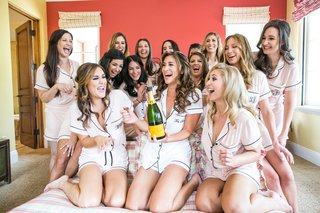 bride-with-veuve-clicquot-champagne-and-bridesmaids-in-summer-pajama-short-sleeve-shorts-set