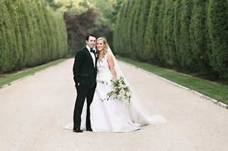wedding-portrait-couple-bride-and-groom-formal-wedding-in-driveway-of-oheka-castle-in-new-york